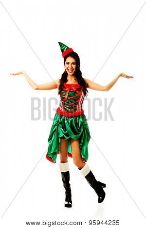Woman with open hands gesture wearing elf clothes.