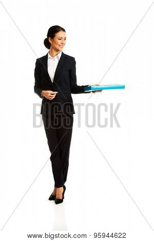 Businesswoman giving a binder to someone.