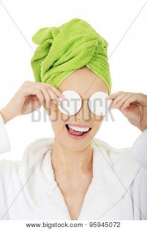 Beautiful caucasian woman with cotton pads.