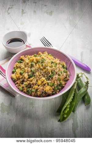 barley risotto with green peas scramble eggs and soy sauce