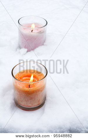 Snow and glass candles