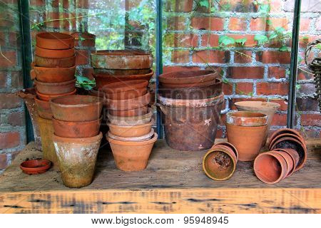 Terracotta garden pots and containers in a garden shed.