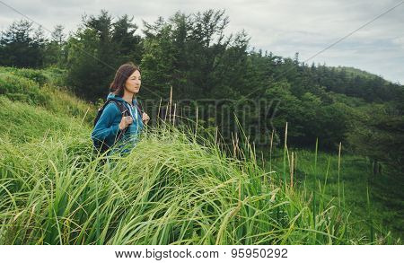 Tourist Young Woman Walking Among High Grass