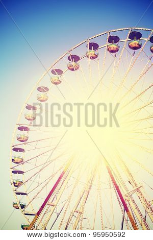 Vintage Instagram Filtered Picture Of A Ferris Wheel.
