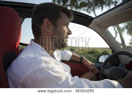 Man With Stubble Driving Rental Car