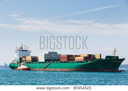 Big Container Ship With Towboat