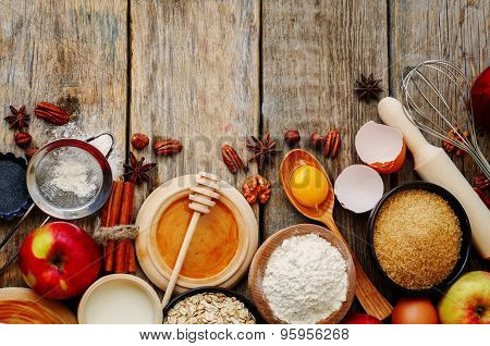Baking Wood Background With Apples, Nuts, Honey, Flour And Butter