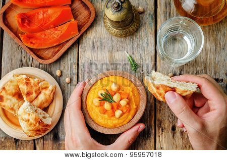 Man Holding Pumpkin Rosemary Hummus