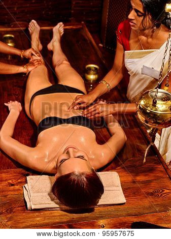 Young woman full lenght having stomach Ayurveda spa treatment.