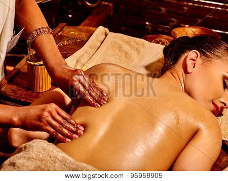 Young woman having Indian spa treatment.