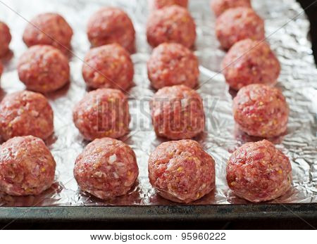 Raw beef meatballs are ready to cook