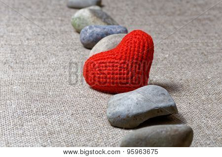 Red Heart In Row Of Stones