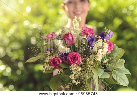 Woman Offering Bouquet Of Fresh Flowers At Camera