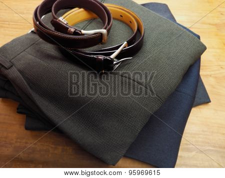 Mens trousers and belt on table ready for use.