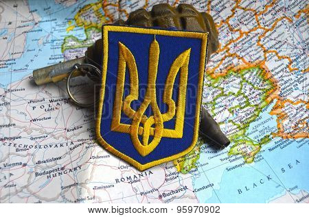 Kiev, Ukraine - July 14, 2015: Ukrainian military chevron.Map of Europe as background. Civil war in Ukraine.July 14,2015 in Kiev, Ukraine