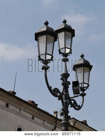 Historical lanterns on a square in Brescia