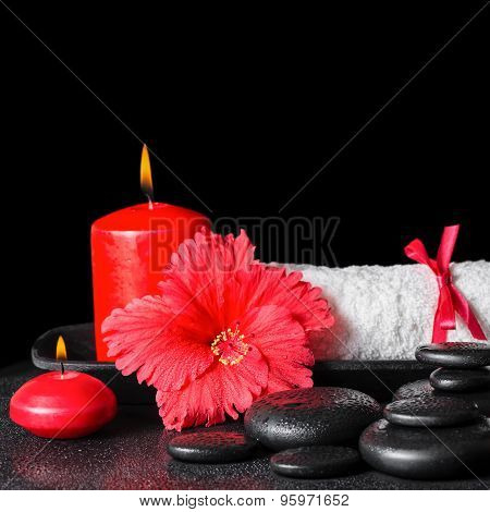 Beautiful Spa Concept Of Red Hibiscus Flower With Dew, Candles And White Rolled Towel Tied With A Ri