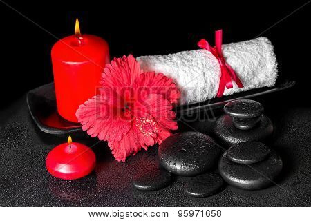 Beautiful Spa Background Of Hibiscus Flower With Dew, Red Candles And White Rolled Towel Tied With R