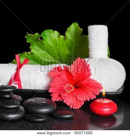 Spa Still Life Of Red Hibiscus Flower With Dew, Candles, Leaf, Thai Herbal Compress Ball And Rolled