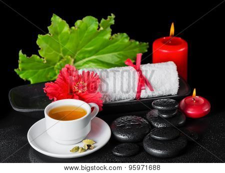 Beautiful Spa Still Life Of Red Hibiscus Flower With Dew, Candles, Green Leaf, Cup Of Tea And Rolled