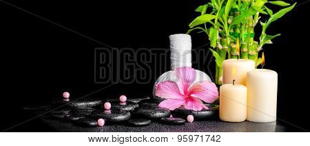 Spa Concept Of Hibiscus Flower, Bamboo, Thai Herbal Compress Ball, Beads And Candles On Zen Basalt S