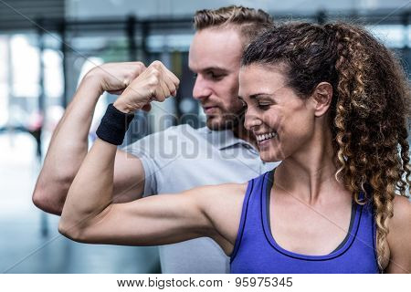 Close up view of a muscular couple flexing biceps