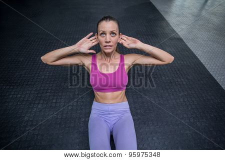 Upward view of muscular woman doing abdominal crunch