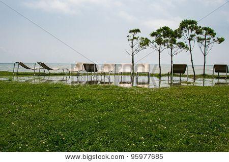 seaside resort, chaise longue, sea, grass, trees Georgia