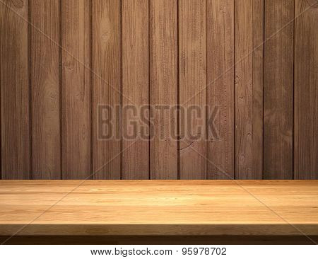 Empty shelf on wooden plank wall
