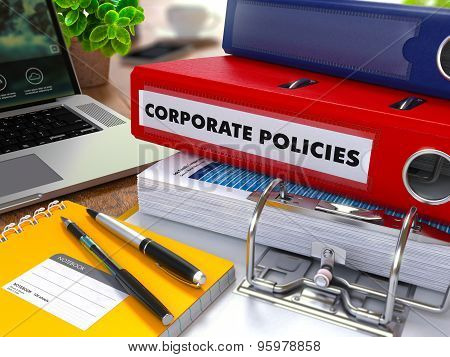Red Ring Binder with Inscription Corporate Policies.