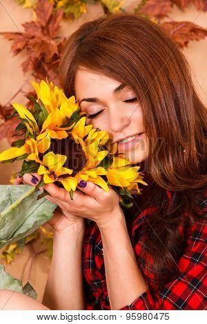 Cute Young Woman Holding The Sunflowers