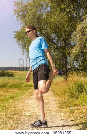 Man Stretching After Jogging