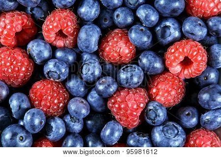 Close Up Fresh Organic  Blueberries And Raspberries. Rich With Vitamins Background, Texture