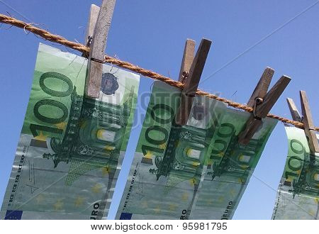 Money hanging on a clothesline