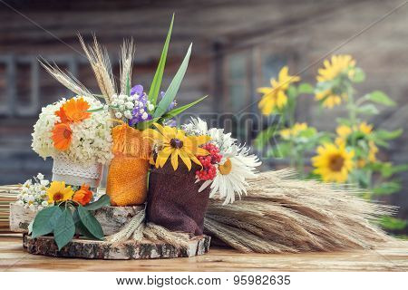 Wedding Decoration In Rustic Style. Still Life With Summer Flowers In A Bags And Ears Of Wheat.