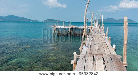 wooden mooring at the beach of the Koh Ku Dee, Thailand