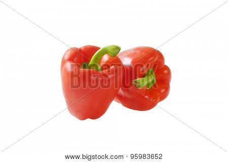 two red bell peppers isolated on white background