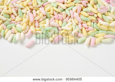 colorful puffed rice on white background