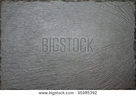 Plain Black Stone Slate Board In Full Frame.