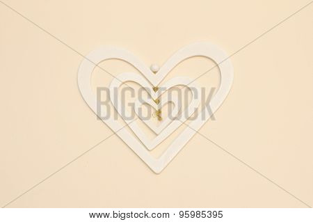 White Wooden Heart Over A Cream Wall