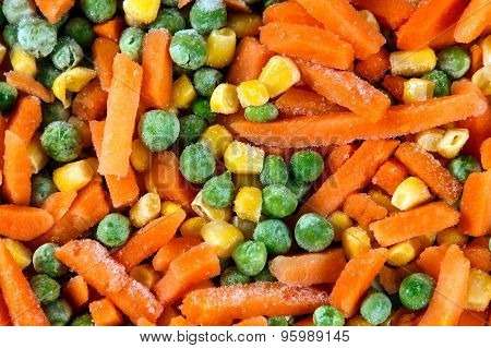 Fresh And Tasty Mix Of Frozen Chopped Vegetables Close-up As Background