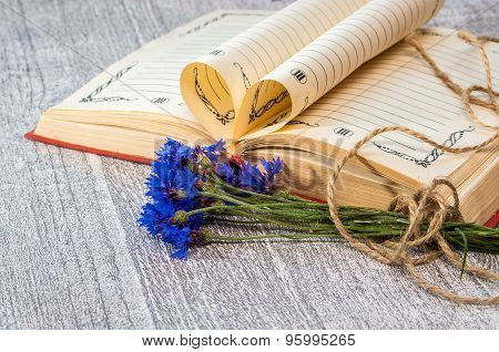 Book Pages Folded Into A Heart And A Flower Of Bouquet Cornflower.
