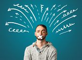 picture of taboo  - Young man with taped mouth and white drawn lines and arrows around his head   - JPG