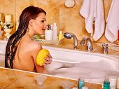 image of bubble bath  - Woman washing and relaxing at water in bubble bath - JPG
