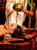 pic of panchakarma  - Young woman having pouring oil head Ayurveda spa treatment - JPG