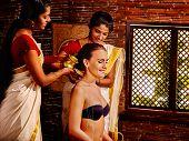 stock photo of panchakarma  - Young woman having ayurveda in Indian spa treatment - JPG