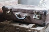 stock photo of old suitcase  - Old retro suitcases in barn - JPG