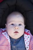 picture of scared baby  - three month baby with jeans dress looking at camera with terror fright face - JPG