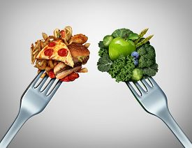 stock photo of struggle  - Diet struggle and decision concept and nutrition choices dilemma between healthy good fresh fruit and vegetables or greasy cholesterol rich fast food with two dinner forks competing to decide what to eat - JPG