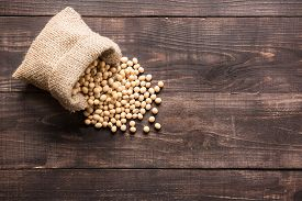 stock photo of soybeans  - Top view soybean on wooden background and empty space - JPG